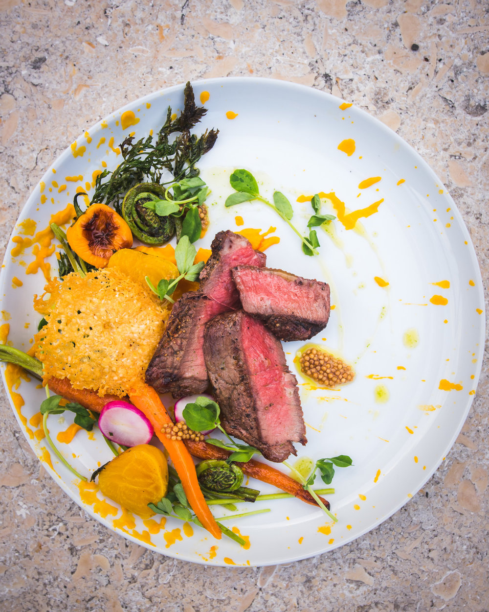 Grilled Striploin Steak with Heirloom Carrots Puree, Fiddleheads and Charred Peppers