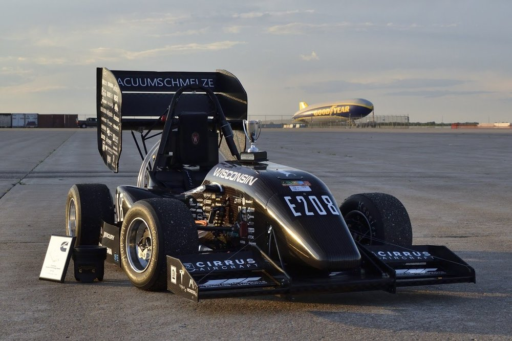 2018 FSAE vehicle that took home a first place in design. Custom electric motors, quad inverter, and Lithium-Ion high voltage battery pack. PC: Swixeler Photography Services