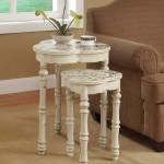 Unique nesting tables in antique white with