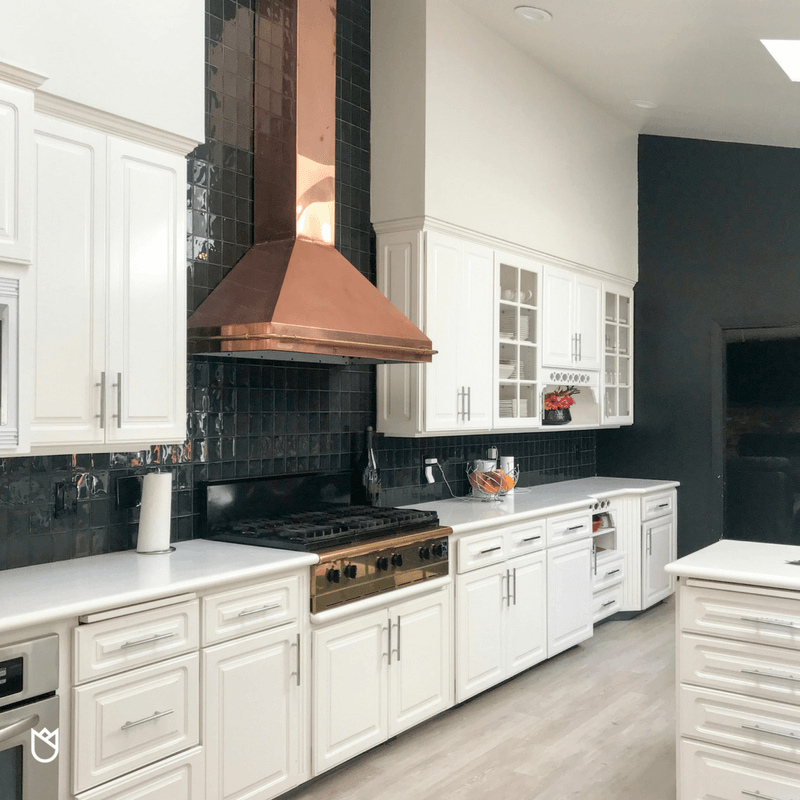 The first thing my eyes landed on was the magnificent copper and gold ventilation hood with a matching cooktop. There was no way I was letting my client demo these