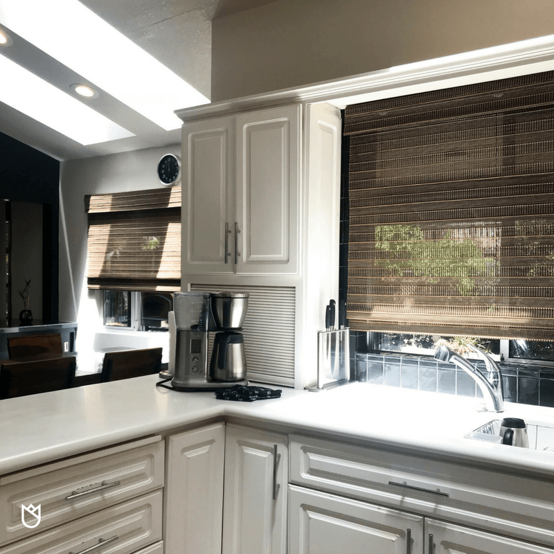 With so many sleek surfaces we needed a bit of texture. Boasting both texture and a natural wood element, woven wood Roman Shades are our favorite