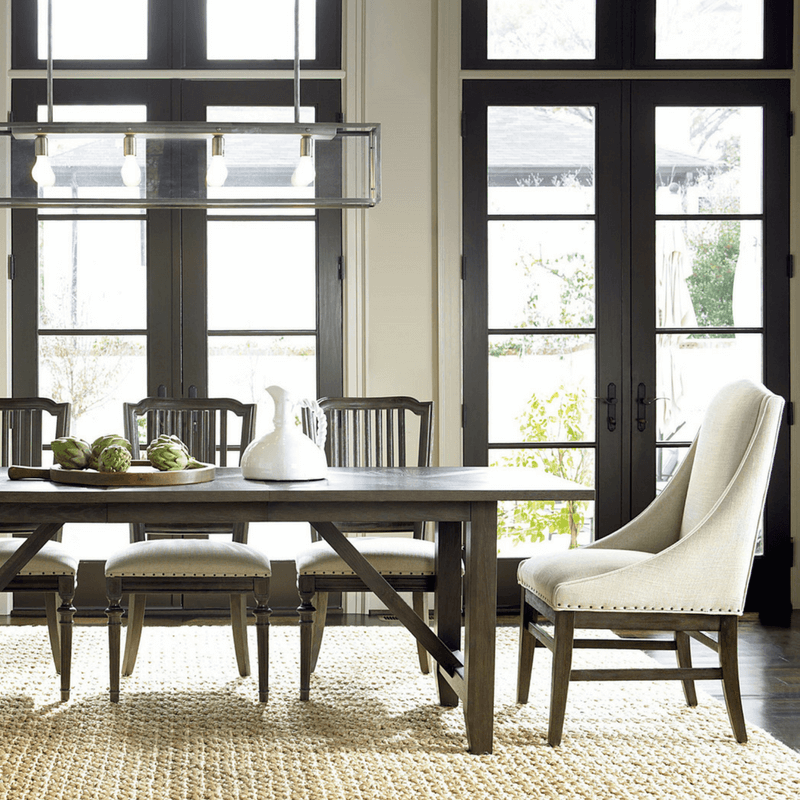 To make it fancier, combine arm chairs and side chairs by putting arm chairs at the head and foot of the table and pile in as many side chairs as you can. I like a combination of upholstered