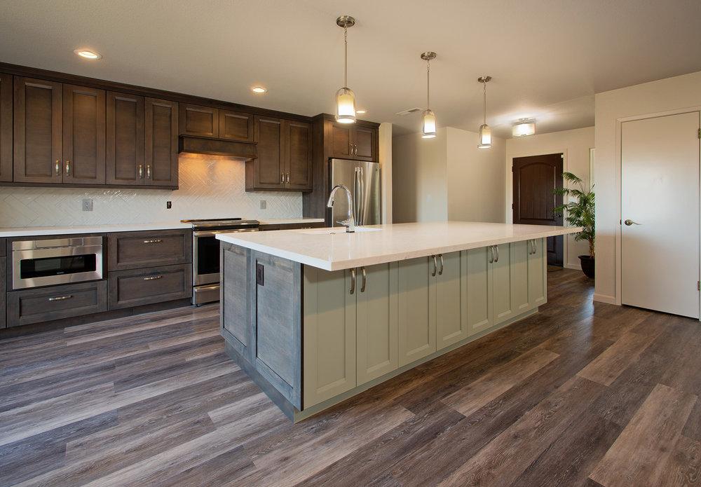 Quartz Countertops:  Marble Palace . Cabinetry:  Bellmont  (dealer – KTJ Design Co). Appliances and Lighting:  Ferguson Showroom.  Tile Backsplash:  Emser Tile . LVP Flooring:  Cortec Flooring . Painting:  Jenco Companies