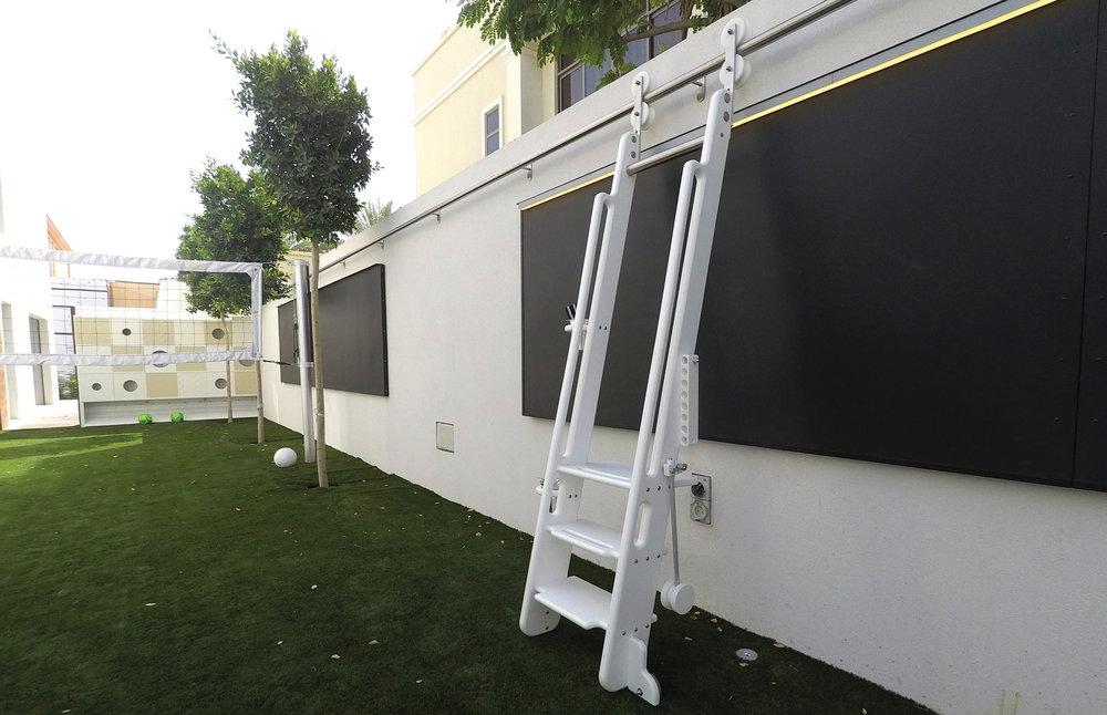 rolling-ladder-art-wall-thinkterior.jpg
