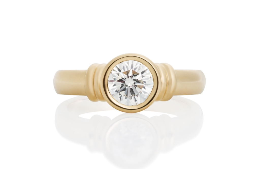 Harbor Light   This statement stone is nestled within a classic gold circle setting, creating a timeless ring that is as practical as it is charming. 1/4ct: $1,175. 1ct: $6,980
