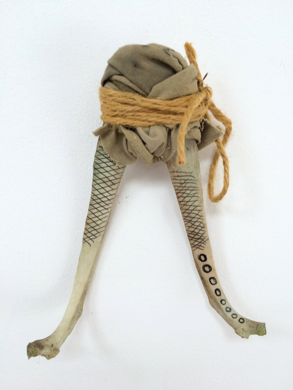 Ghandi ,  2017  deer bones, cotton fabric, twine , ink  h22cm