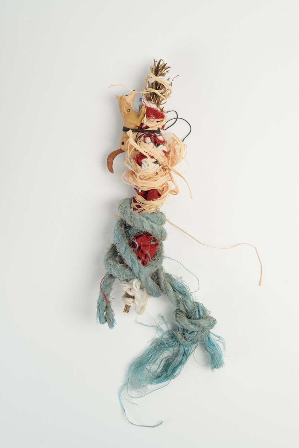 McDonalds,   2018  cloth, rope, string, clay, plastic toy, raffia, thread, dried flower stalk h35cm