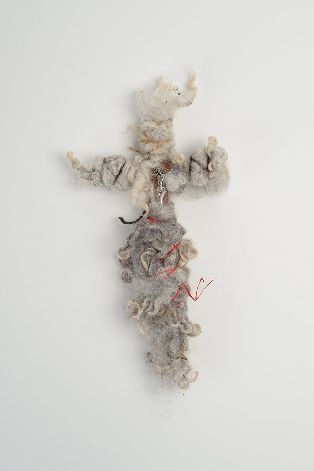 Redemption song 2,   2018  crucifix, wool, thread, twine h21cm
