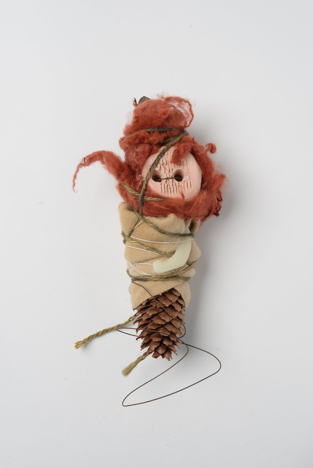 Night-Rider 2,  2017  Pine cone, wool, wax, string, wire, clay h 35cm
