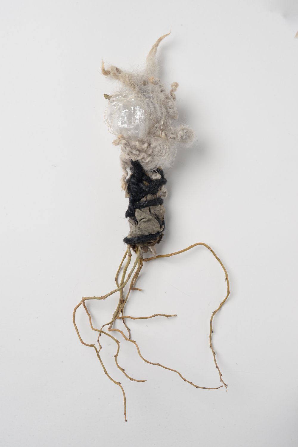 Untitled (plastic),    2017 Twig, wool, cloth, plastic bag, rope h22cm