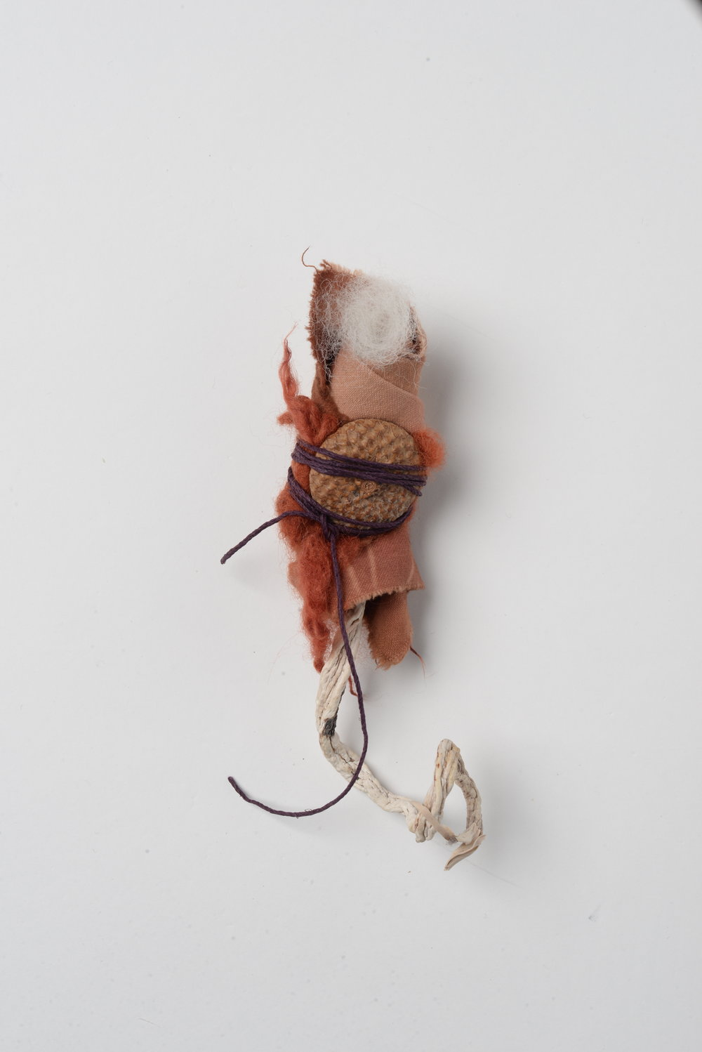 Lullaby,    2017 twig, cloth, acorn-cup, wool, string h15cm
