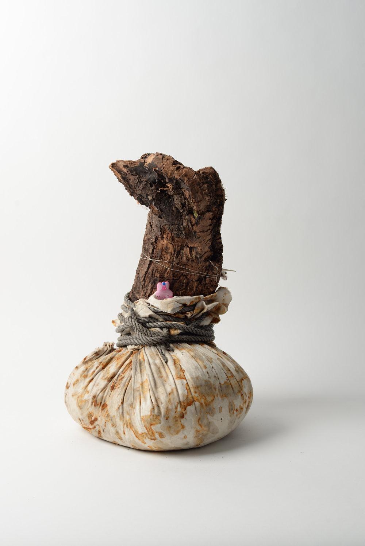 Bunny Totem, 2017 oak, rust-printed cotton, rope, rice, trinket h45cm