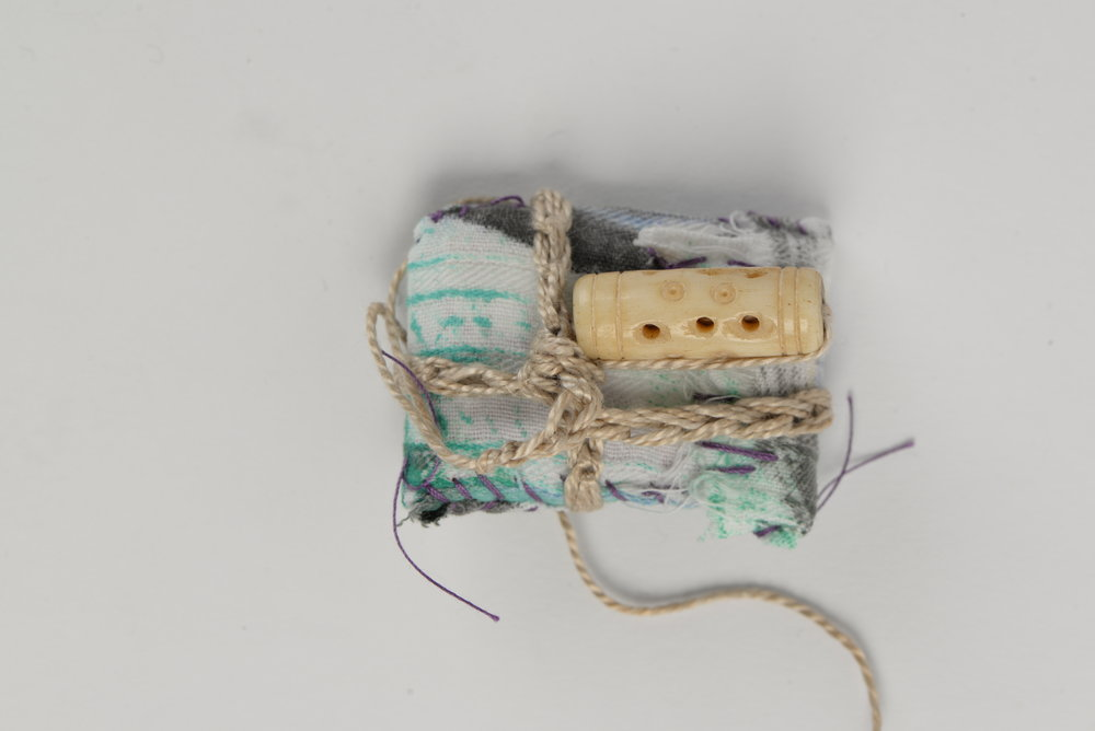 Various Tokens of Gratitude,   2018 words on paper, cloth thread, stones,shells, trinkets 4x5cm