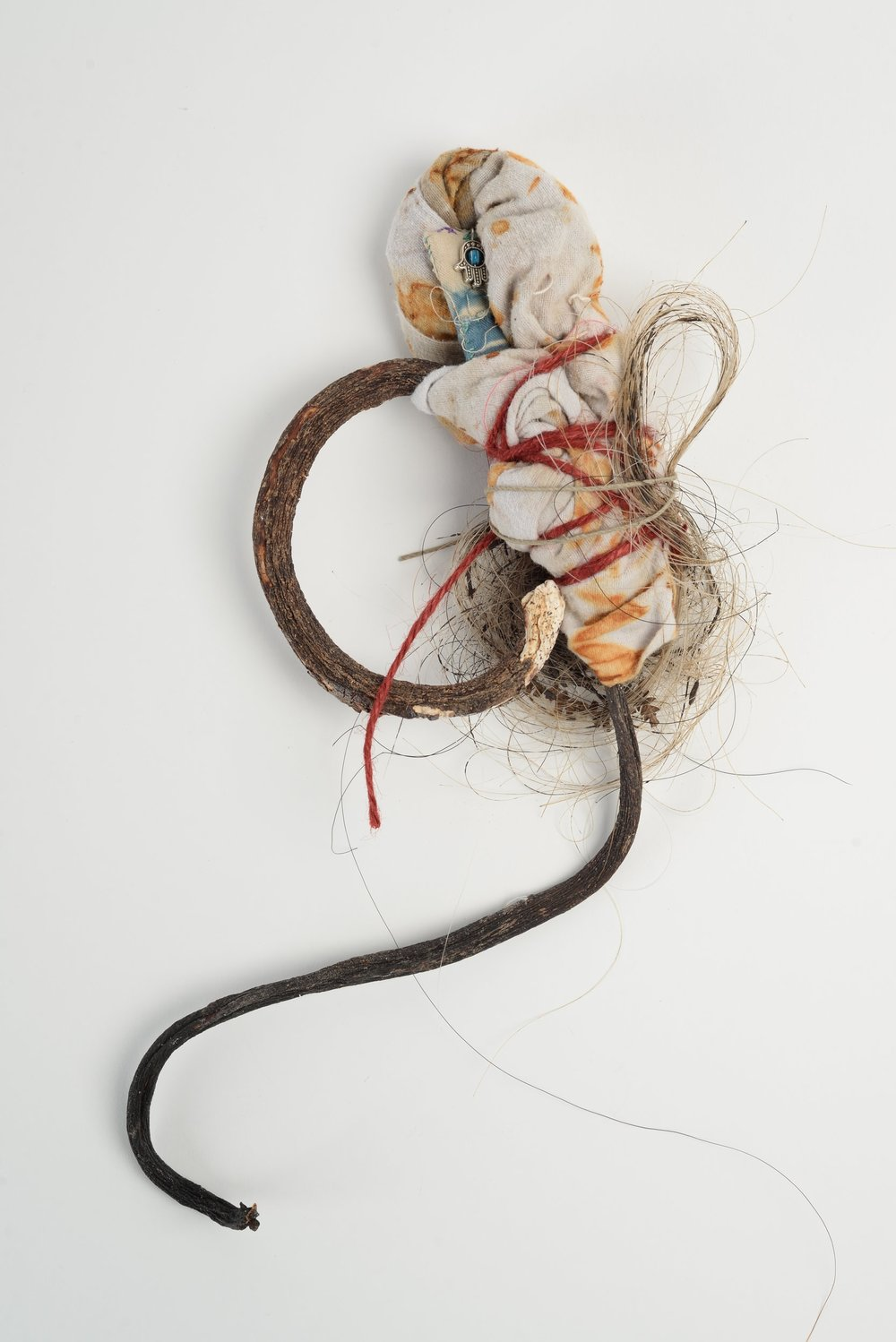 Untitled(curly),  2017 seaweed, rust-printed cloth, horse-hair, token of gratitude h33cm