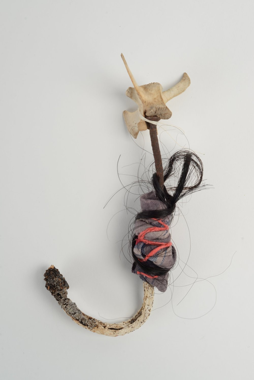 Untitled (nail),   2018  seaweed, deer vertebrae, rusty nail, horse-hair, cloth, string h 25cm
