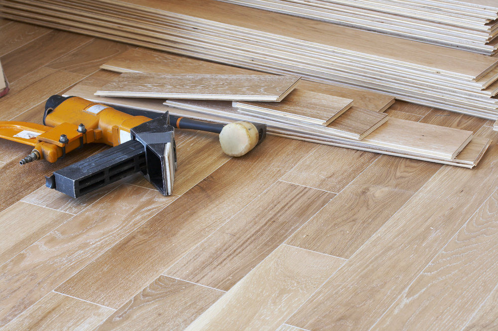 a picture of wood flooring and tools