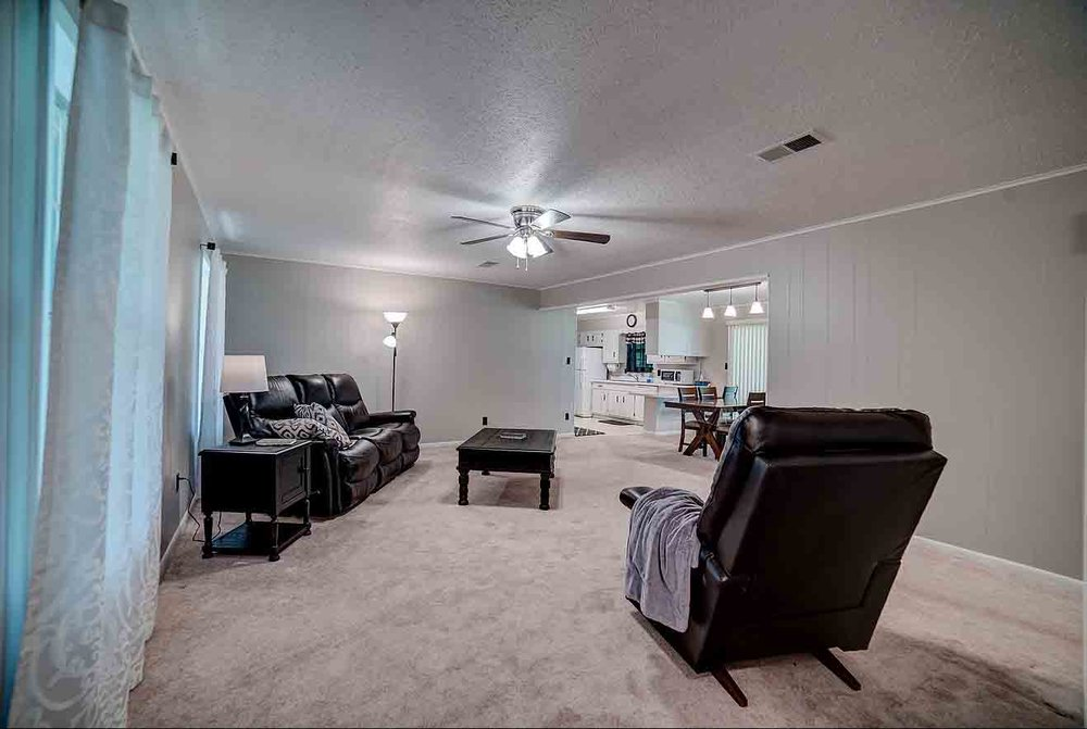 Large, carpeted family room