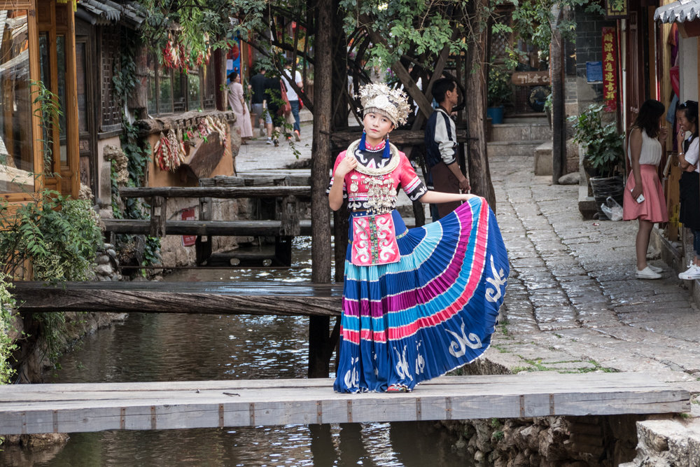Naxi minority woman dancing in the street