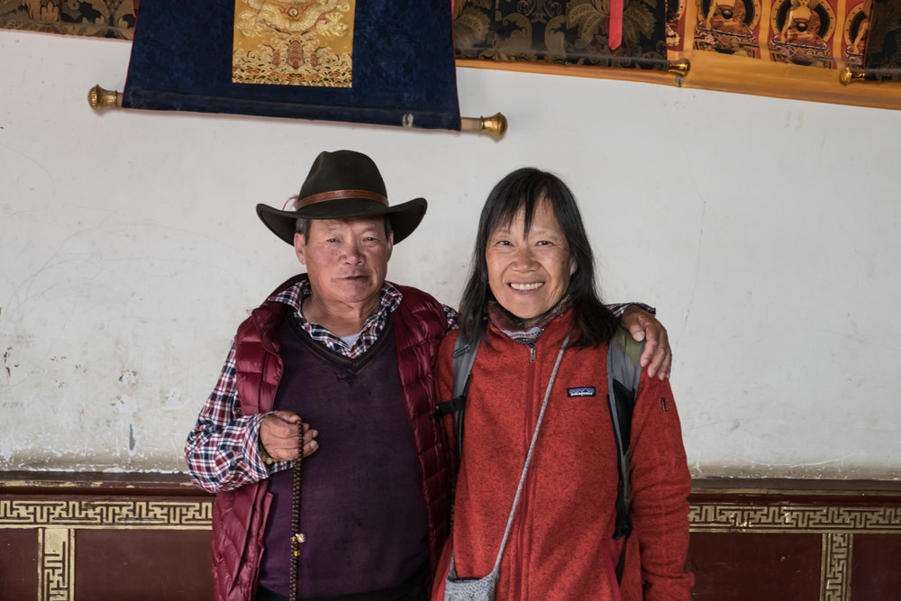Friendly Tibetan Buddhist who waved us to come in the room with prayer wheels