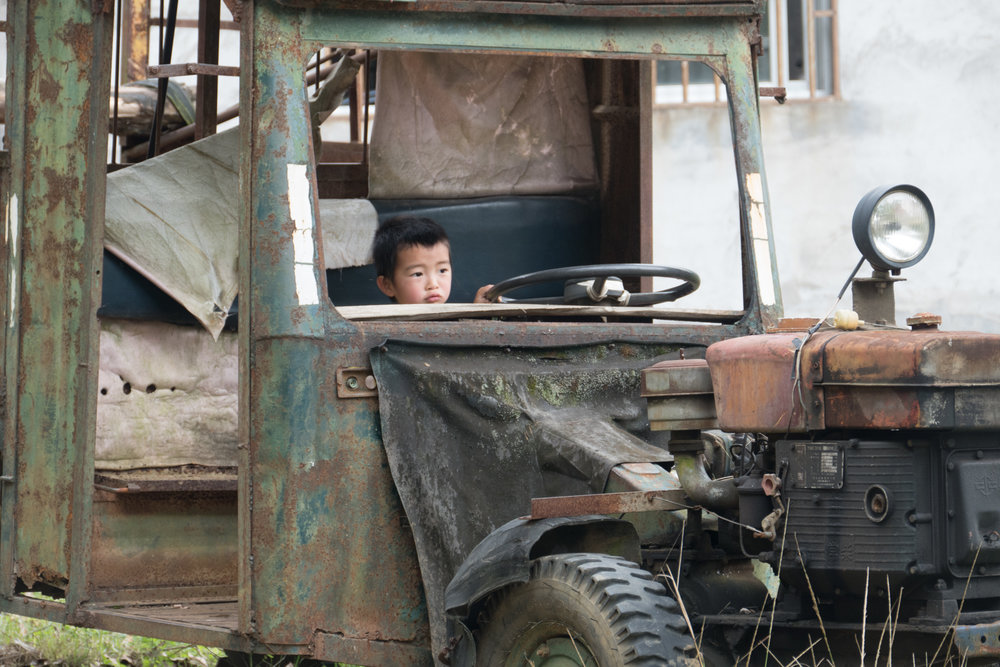 Boy playing in old truck