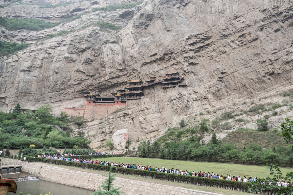 The hanging temple was built on the sheer face of a cliff. This also shows part of the long line to get in.