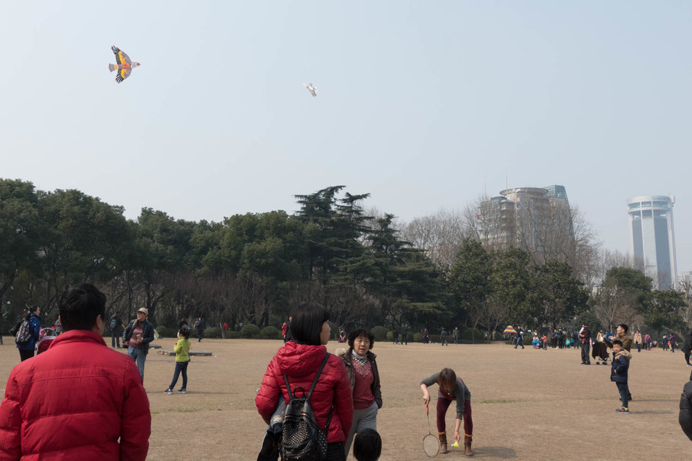 Flying kites, playing badminton