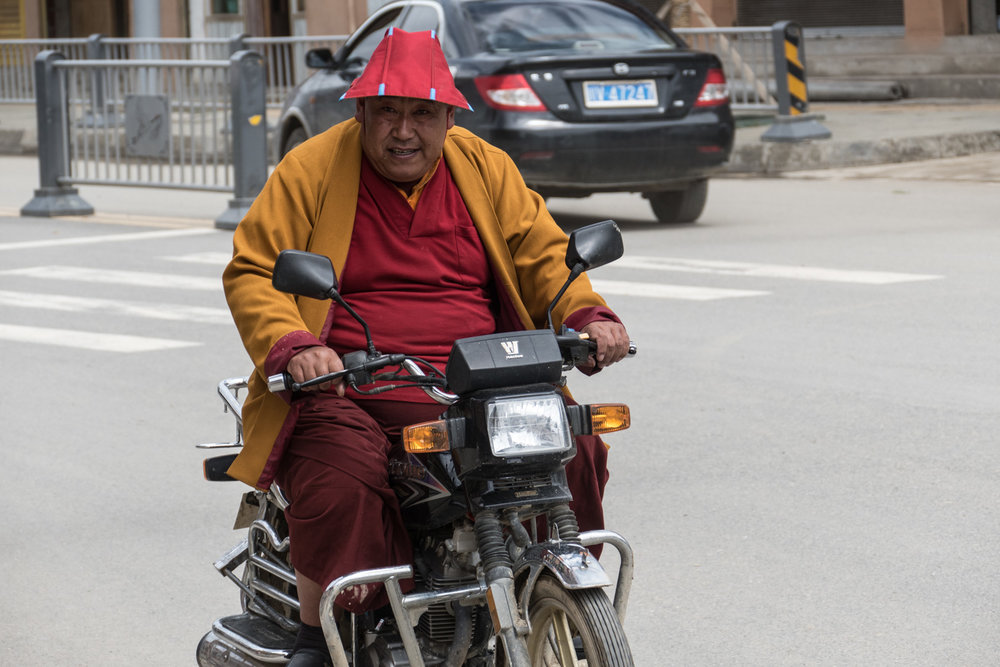 For some reason I find monks on motorcycles very funny