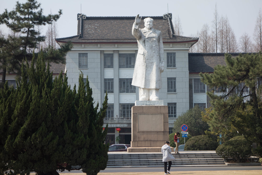 On the campus of East China Normal University where I had an office in the building in the background. The faculty would joke that they were making plans behind Mao's back.