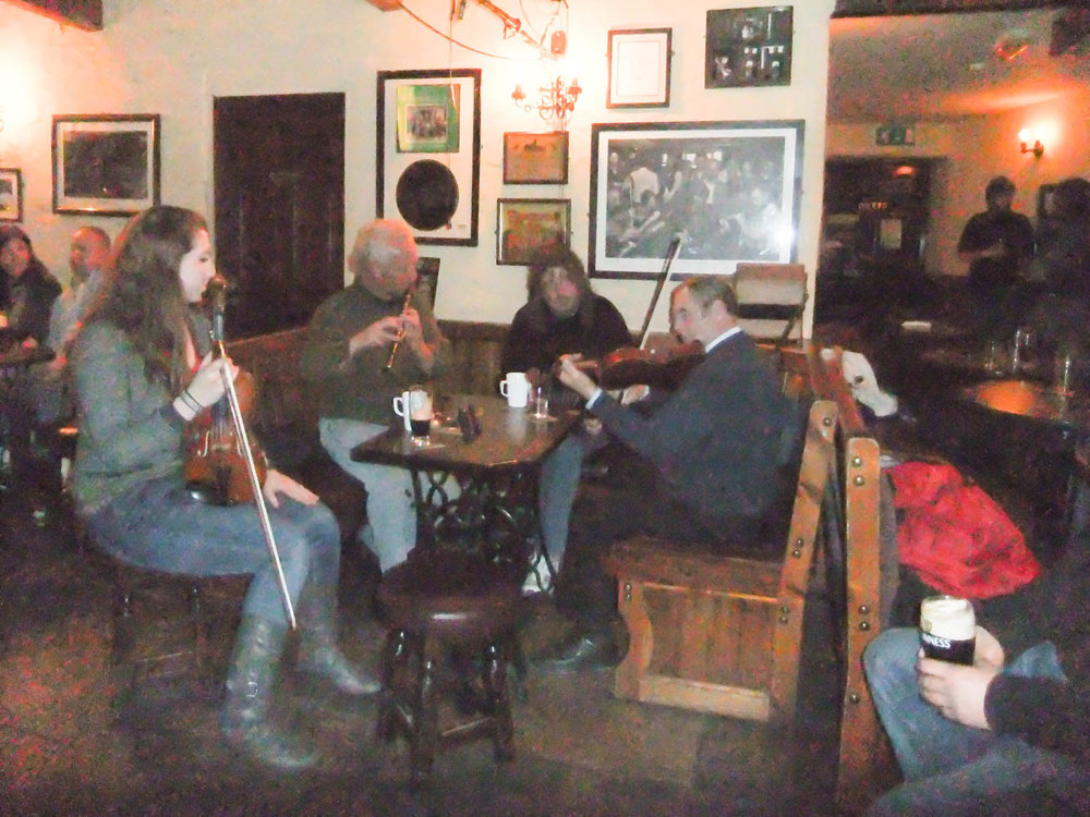 In Doolin at Gus O'Connor's Pub with the Canadian girl on the left joining the band