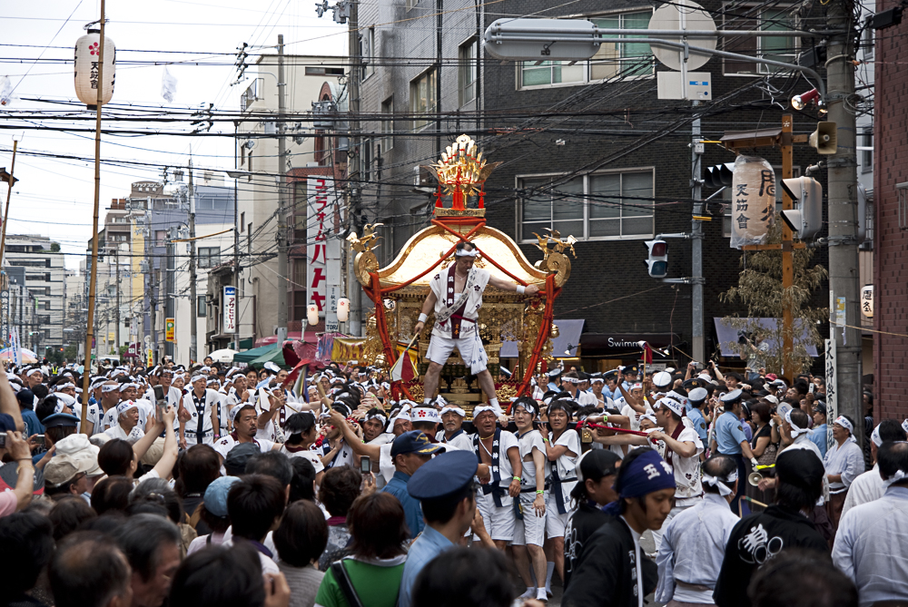 One of the shrines being carried down the street to a cacophony of sound