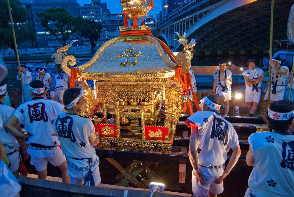 Loading a shrine onto a boat at night