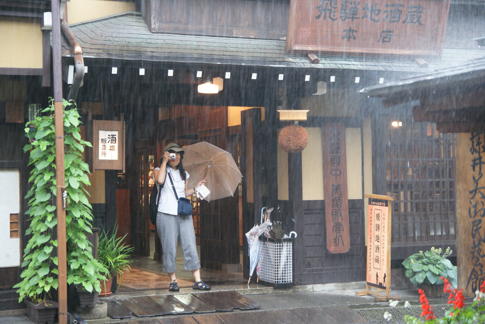 Caught in a down pour in the old town of Takayama