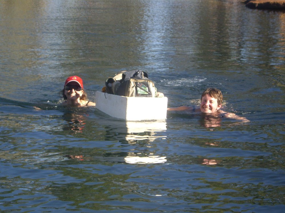 Swimming to Manning Gorge with essentials in a styrofoam boat