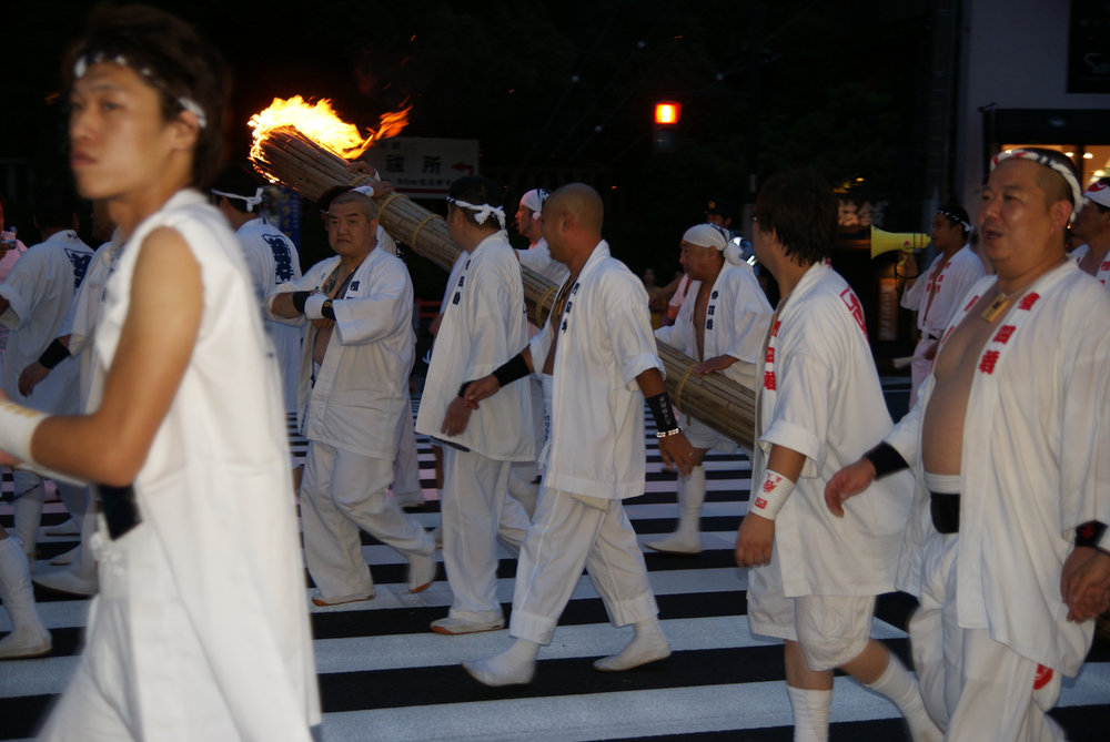 Parade at night in the Gion district of Kyoto