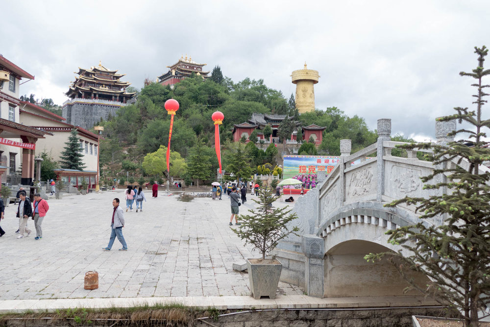 View from the city center of Guishan Temple and Zhuangjing Tong Prayer Wheel, the tallest one in the world on the right