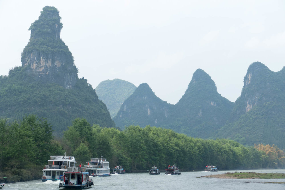 The flotilla of tour boats on the Li River. At the most scenic parts of the trip, there's a mob of tour boats jockeying to get the front position. Not the most relaxed trip down the river.