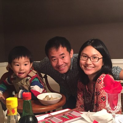 Xiyue Wang and Hua Qu with their son.