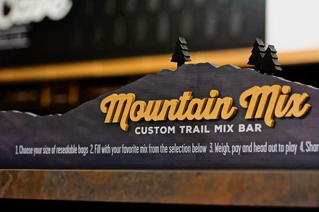 Custom dimensional signage doesn't always have to be used large scale to make an impact. Sometimes it can be small and exist in one of the common areas of your store and still achieve a huge impact. ⠀⠀ ⠀ We created this beautiful signage for @honeybeeproduce to highlight their custom trail mix bar. ____ #honeybee #bee #thehive #mountainmix #signagedesign #custom #dimensional #dimensionalsignage #trail #refuel #powerup #utah #grocerydecor #interiordecor #interiordesign