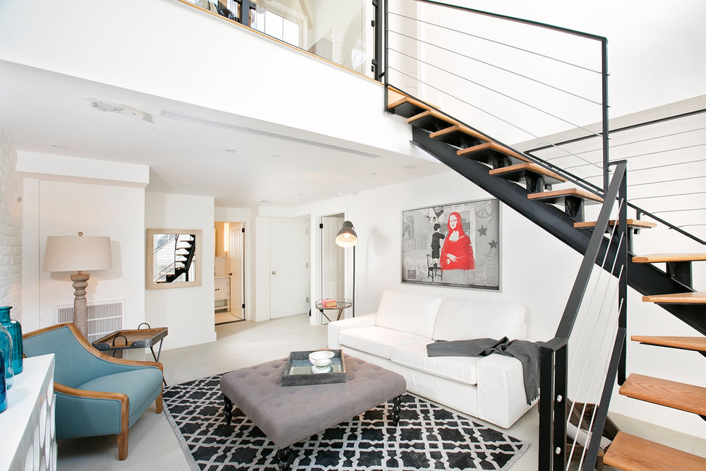 Residence 1B is very dramatic. - This sprawling Garden Duplex hits the mark.