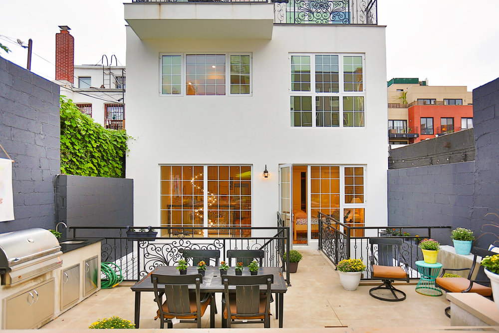 The BACK YARD - The most amazing space in this apartment is the huge multi-level private backyard.