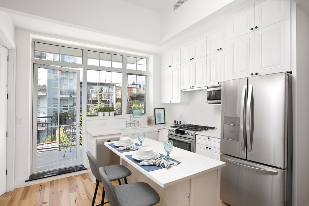 Residence 3B warm & inviting. - The casement window brings a lovely feeling upon walking in.