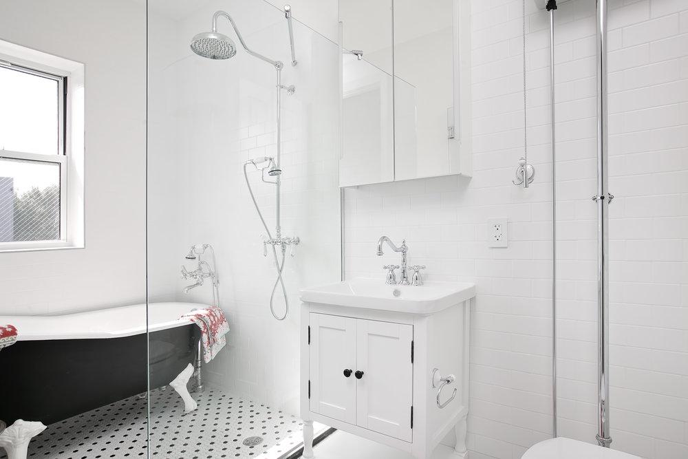 THE BATHROOM - Deep soaking Cast Iron clawfoot tubs.