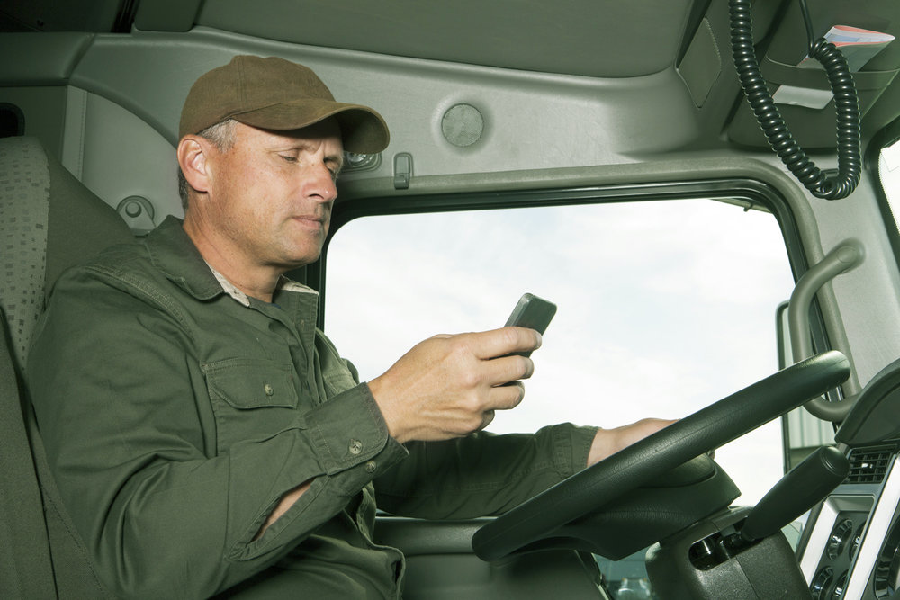 Distracted truck driver texting while driving.