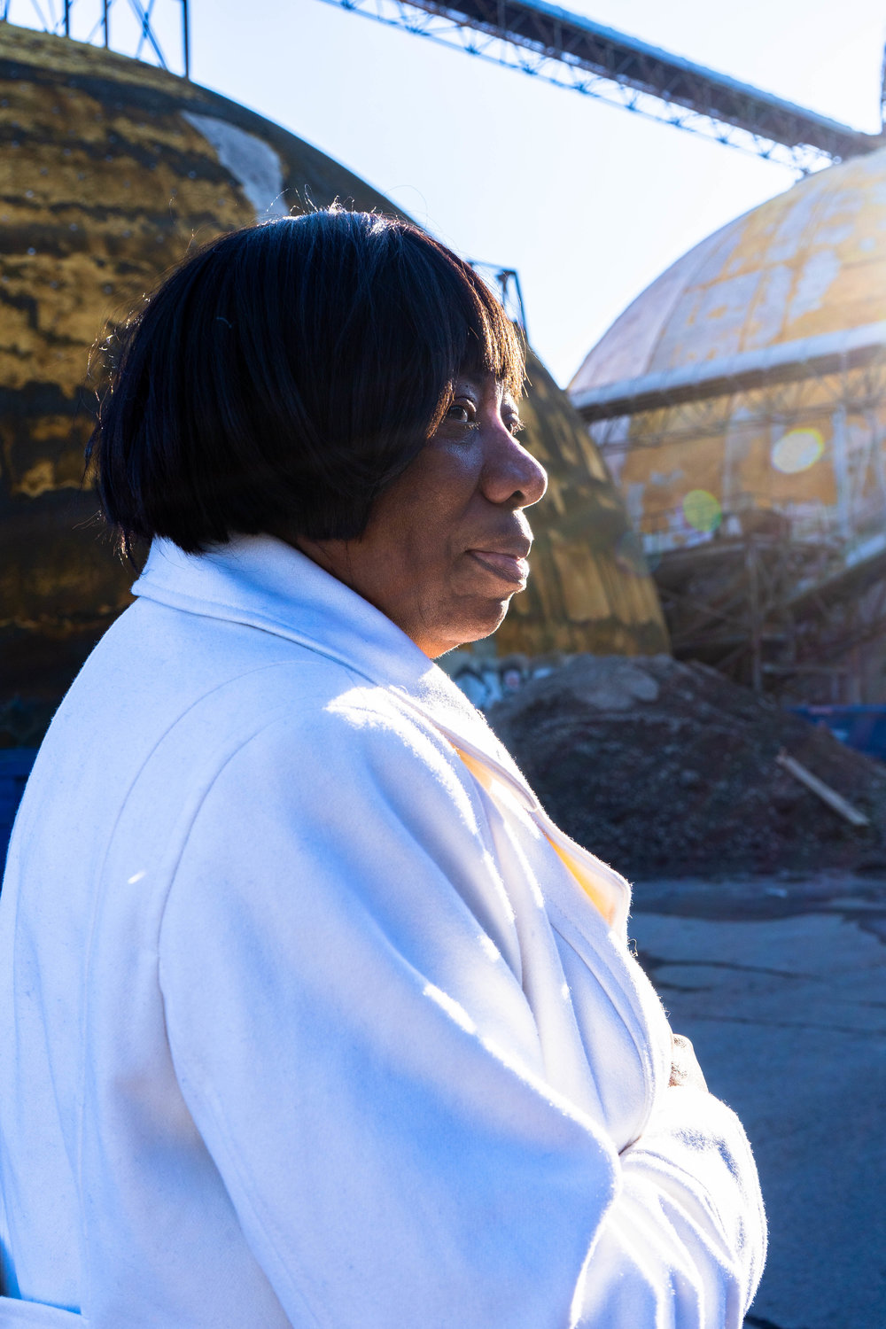 Catherine Fleming stands by the domes at the Upper Harbor Terminal site.