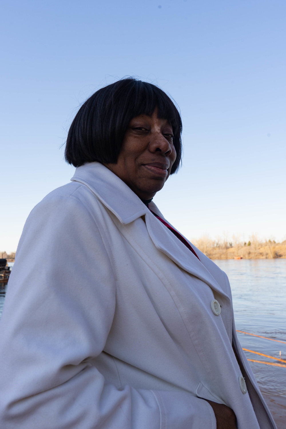Catherine Fleming stands on the edge of the Mississippi River for a portrait at the Upper Harbor Terminal site.