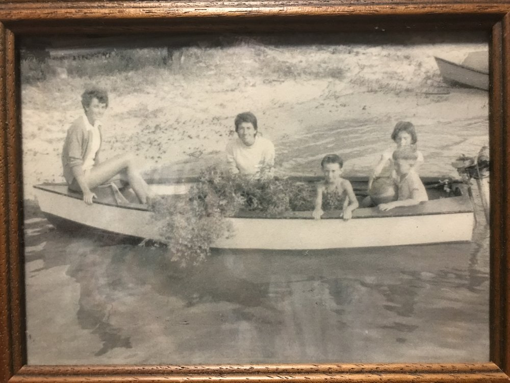 Boy in Boat Painting- the photo