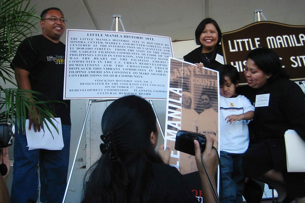 Little Manila Rising co-founders Dillon Delvo (far left) and Dawn Bohulano Mabalon (far right) at the dedication event for the Little Manila Historic Site in Stockton, California. Courtesy of Dillon Delvo.