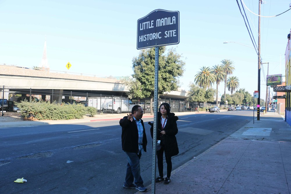Little Manila Rising co-founder and executive director Dillon Delvo and Long Distance host and producer Paola Mardo at the Little Manila Historic Site in Stockton, California. Photo by Patrick Epino.