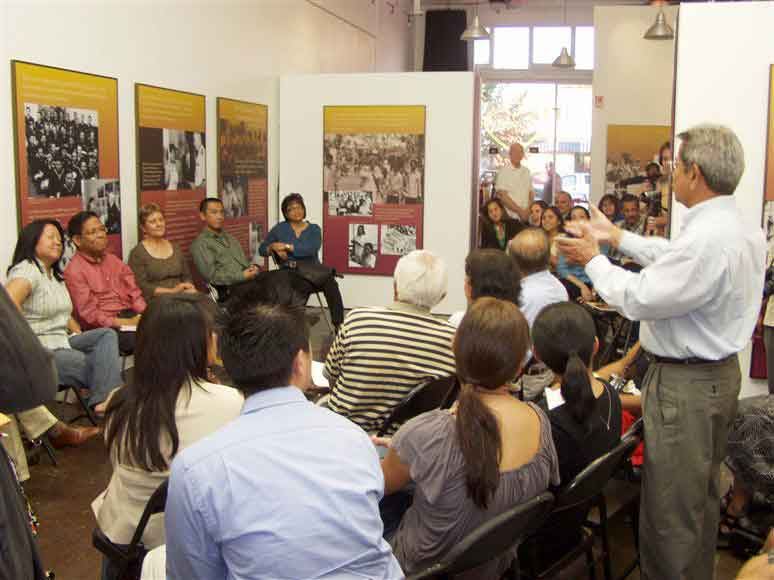 Gregory Villanueva (standing) talks to Carlene Sobrino Bonnivier (second from left on the panel). The two of them just met and learned they went to elementary school together in the 1940s. This was a panel for writers from LA's Historic Filipinotown held at the old Remy's Art Gallery on West Temple Street on October 18, 2008.