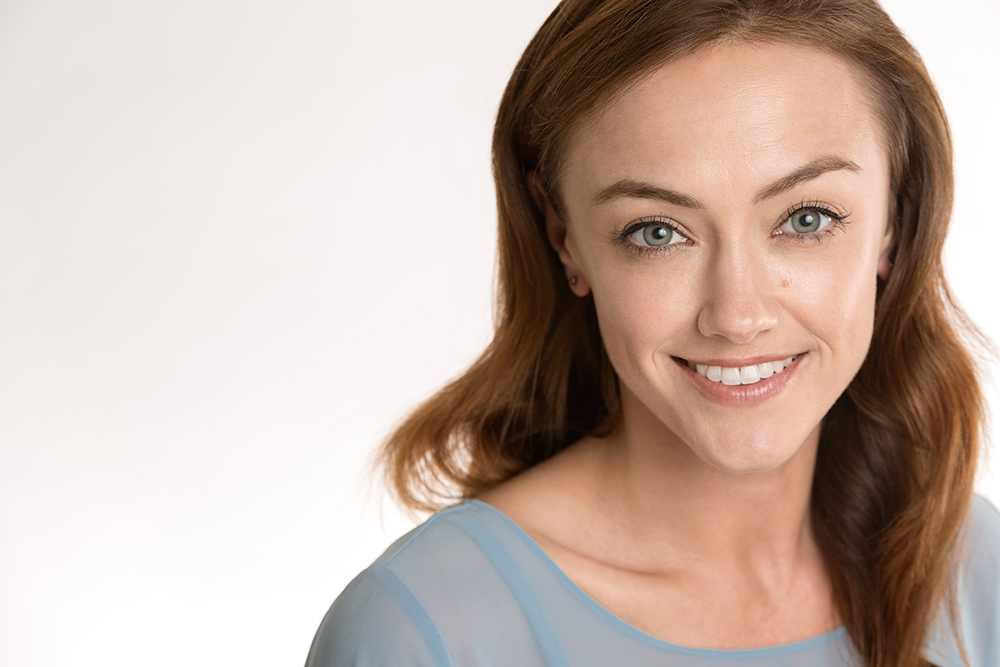 Laine-O'Connor-commercial-headshot-blue-top.jpg